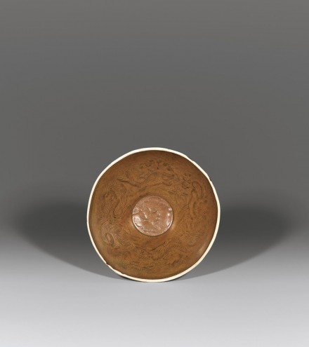 A BROWN-GLAZED MOULDED DINGYAO BOWL