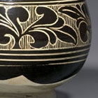 A CARVED 'BLACK- AND WHITE'-GLAZED CIZHOU STONEWARE BOWL