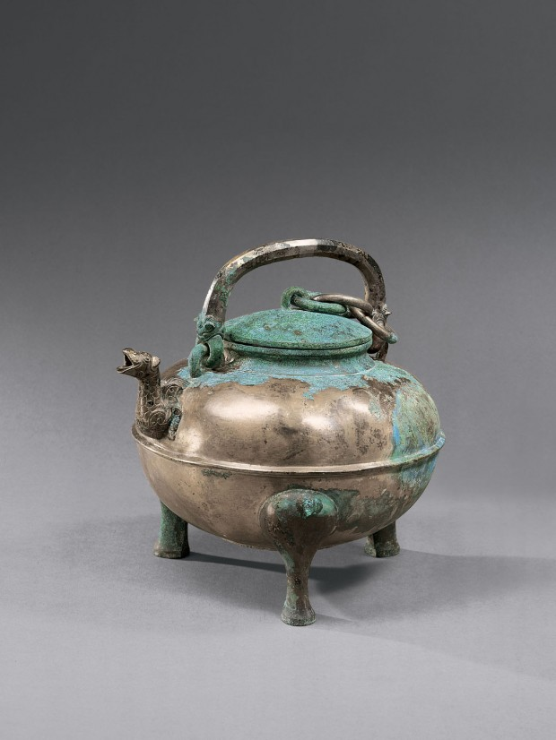 An Archaic Bronze Ritual Covered Tripod Wine Vessel (He)