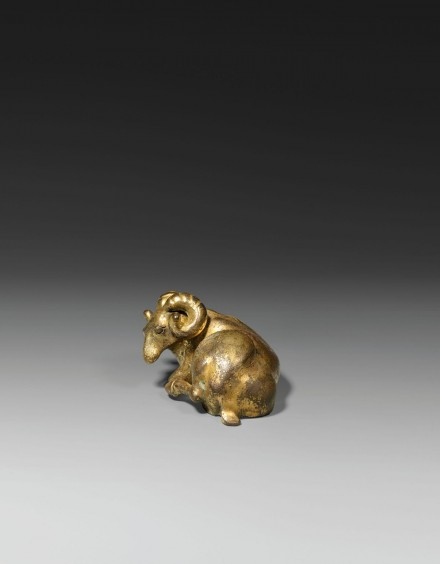 A GILT BRONZE RAM-FORM WEIGHT