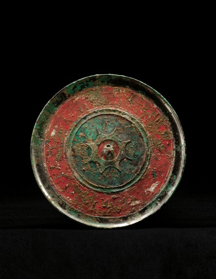 A PAINTED BRONZE MIRROR