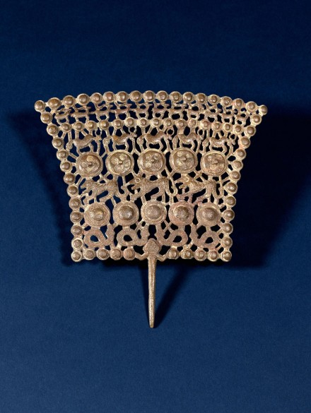 AN ARCHAIC BRONZE OPENWORK ORNAMENTAL PLAQUE