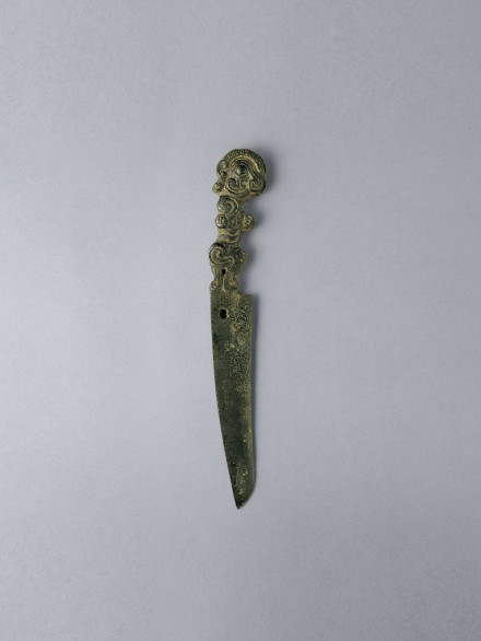 A Bronze Knife With Handle in the Form of a Mythical Beast