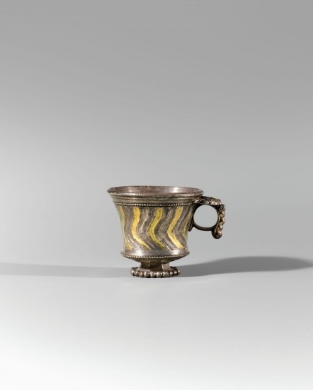 A SOGDIAN PARCEL-GILT SILVER FLUTED CUP