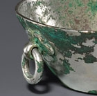 A SMALL OVAL SILVER BASIN WITH RING HANDLE