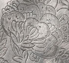 A SILVER DISH WITH CHASED FOLIATE DECORATION