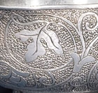 A PAIR OF SMALL CHASED SILVER CUPS