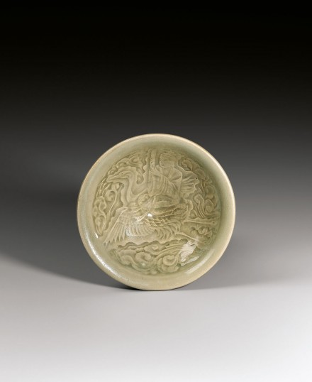 A YAOZHOU CELADON BOWL MOULDED WITH A DAOIST IMMORTAL RIDING ON A CRANE