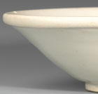A GLAZED WHITE PORCELAIN SHALLOW BOWL