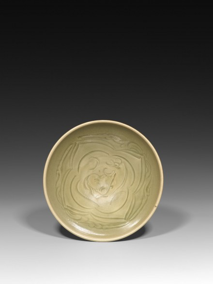 A CARVED YAOZHOU CELADON 'XINIU GAZING AT THE MOON' BOWL