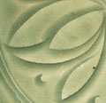 A CARVED YAOZHOU CELADON DEEP BOWL