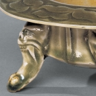 A CARVED YAOZHOU CELADON INCENSE BURNER ON 'MONSTER-MASK' LEGS