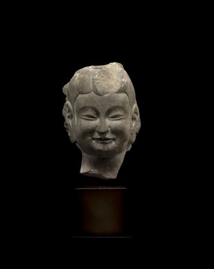 A GRAY LIMESTONE RELIEF HEAD OF A BODHISATTVA