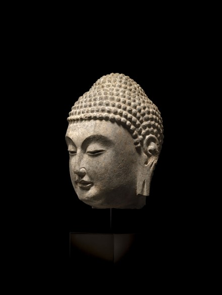A GRAY LIMESTONE HEAD OF BUDDHA
