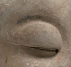 A SANDSTONE HEAD OF A BUDDHIST DISCIPLE