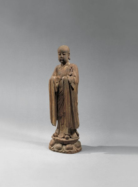 A WOOD FIGURE OF A BUDDHIST MONK