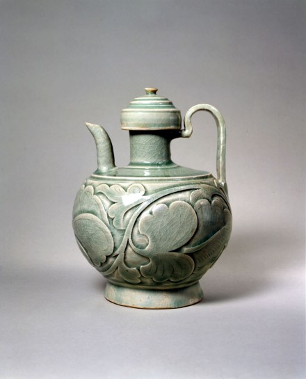 AN EARLY CARVED YAOZHOU CELADON EWER AND COVER