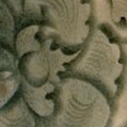 A CARVED YAOZHOU CELADON CONICAL BOWL