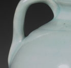 A QINGBAI GLAZED PORCELAIN EWER AND COVER