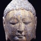 A GRAY LIMESTONE HEAD OF THE BUDDHA