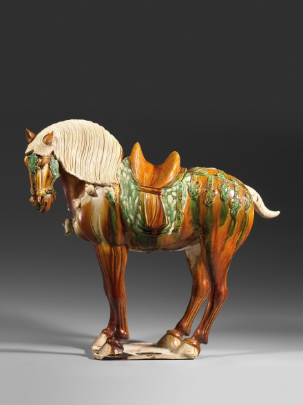 A SANCAI-GLAZED POTTERY FIGURE OF A SADDLED HORSE