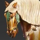 A SANCAI-GLAZED POTTERY FIGURE OF A SADDLED HORSE