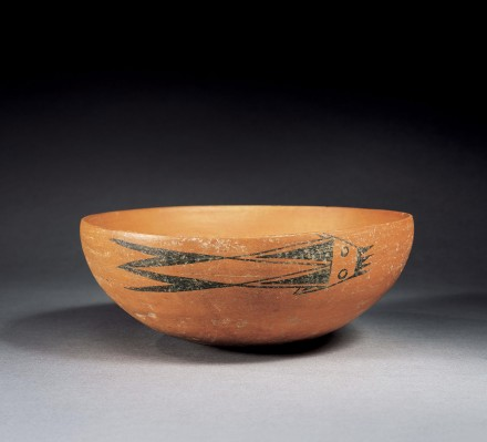 A NEOLITHIC RED POTTERY BOWL WITH PAINTED FISH DESIGN