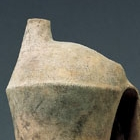 A TALL NEOLITHIC POTTERY TRIPOD EWER
