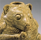 A YUEYAO GLAZED STONEWARE BEAR-FORM VESSEL