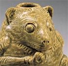 A YUEYAO GLAZED STONEWARE BEAR-FORM VESSEL