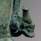 AN ARCHAIC BRONZE WINE VESSEL AND COVER (YOU)