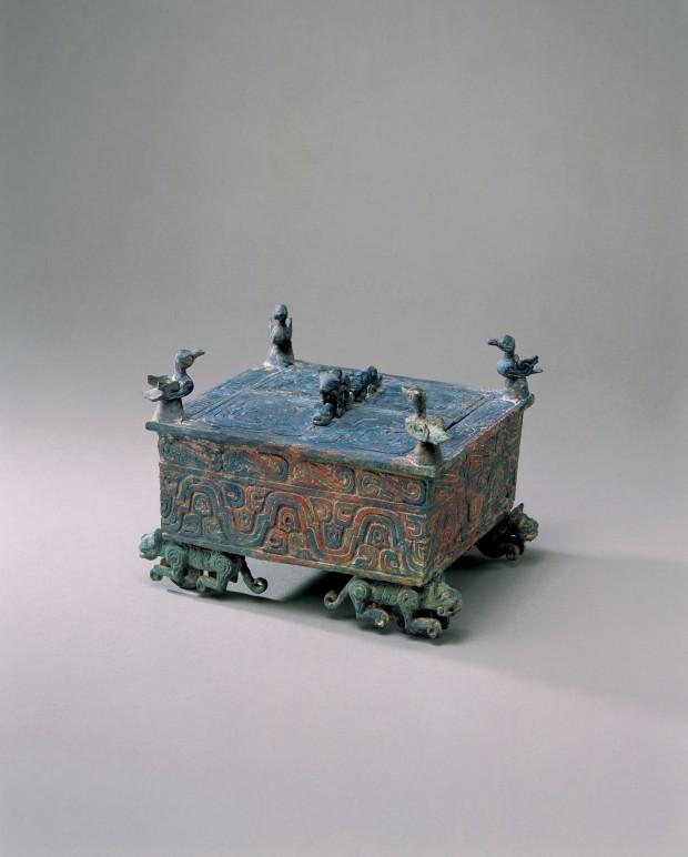AN ARCHAIC BRONZE BOX ON WHEELED TIGERS