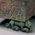 AN ARCHAIC BRONZE BOX ON WHEELED TIGERS