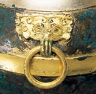 A GILDED AND SILVERED BRONZE COVERED VESSEL (HU)