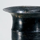 A NEOLITHIC BLACK POTTERY CUP ON HIGH FOOT