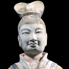 A LARGE PAINTED POTTERY FIGURE OF A COURT DIGNITARY