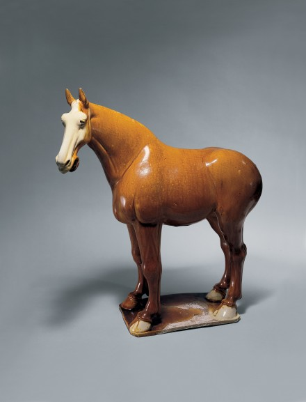 AN AMBER-GLAZED POTTERY FIGURE OF A HORSE