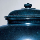 A LARGE BLUE-GLAZED POTTERY JAR AND COVER