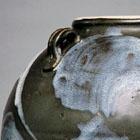 A LARGE BLUE-SPLASHED BROWN-GLAZED STONEWARE JAR