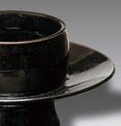 A BLACK-GLAZED STONEWARE CUPSTAND