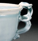 A YINGQING GLAZED PORCELAIN DRAGON-HANDLED WINECUP