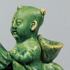A GREEN-GLAZED POTTERY 'BOY AND PHOENIX' EWER