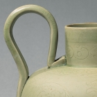 A YUE WARE EWER WITH ENGRAVED DECORATION