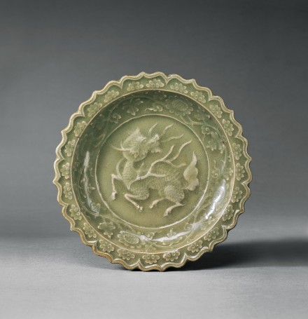 A MOULDED LONGQUAN CELADON DISH WITH QILIN