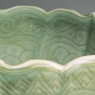 A CARVED LONGQUAN CELADON BOWL