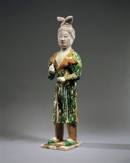 A LARGE SANCAI GLAZED POTTERY ATTENDANT