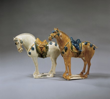 A PAIR OF SANCAI AND BLUE GLAZED POTTERY HORSES