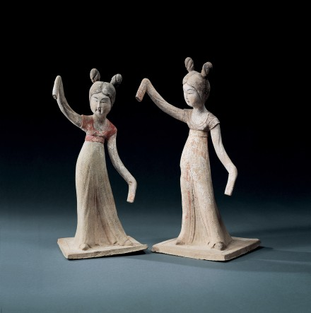 A PAIR OF PAINTED POTTERY DANCERS