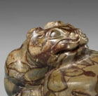 A PUDDINGSTONE TIGER-FORM MAT WEIGHT