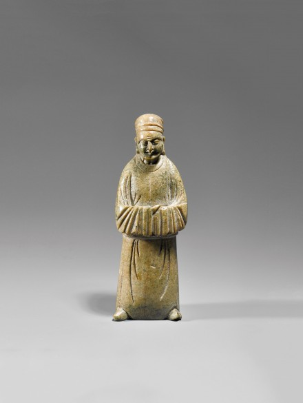 AN EARLY SOAPSTONE CARVING OF A SAGE